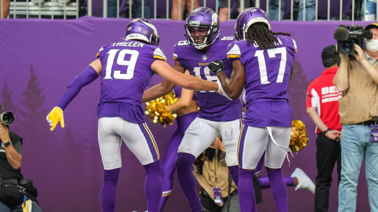 Minnesota Vikings wide receiver Justin Jefferson celebrates a touchdown with wide receiver Adam Thielen during the second quarter against Seattle Seahawks at U.S. Bank Stadium.