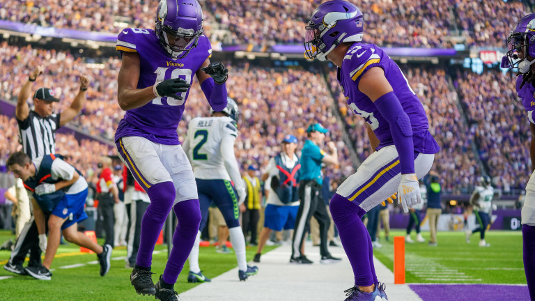 Minnesota Vikings wide receiver Justin Jefferson celebrates his touchdown with wide receiver Adam Thielen against the Seattle Seahawks in the second quarter at U.S. Bank Stadium.