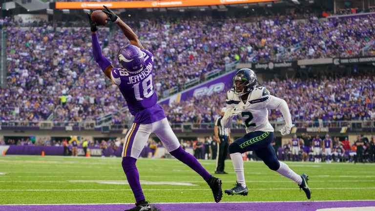 Minnesota Vikings wide receiver Justin Jefferson catches a pass for a touchdown against the Seattle Seahawks defensive back D.J. Reed in the second quarter at U.S. Bank Stadium.