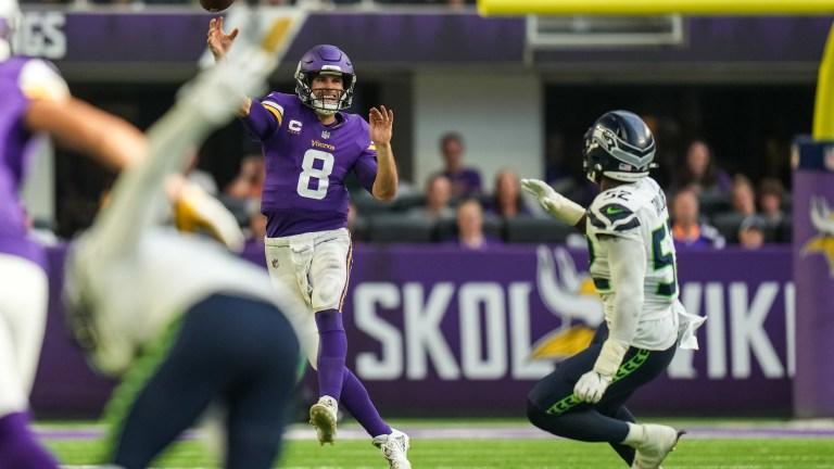 Minnesota Vikings quarterback Kirk Cousins throws during the third quarter against Seattle Seahawks at U.S. Bank Stadium.